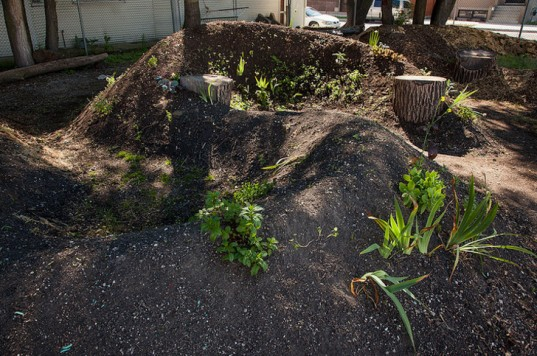 http://inhabitat.com/diy-hugelkultur-how-build-raised-permaculture-garden-beds/