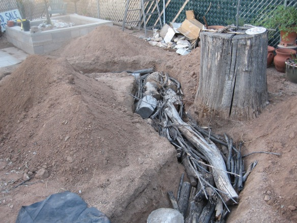 logs, sticks and twigs in the trench first