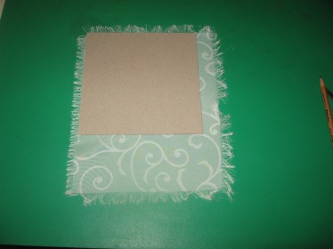 using the chipboard template to mark the swatches