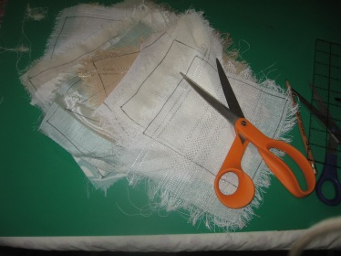 using the chipboard template to mark the swatches. Outline with marker first, then cut inside the line